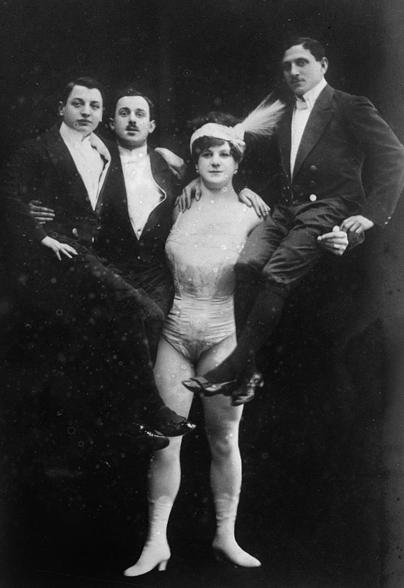 photograph of circus strongwoman Katie Sandwina holding three men in the air